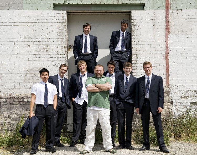 Director Dean Paul Gibson and the younger portion of the cast of The History Boys. Photo by David Cooper